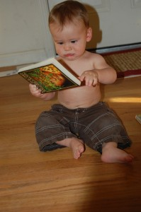 "Nesta ""reading"" Lord of the Flies at 8 or 9 months old."